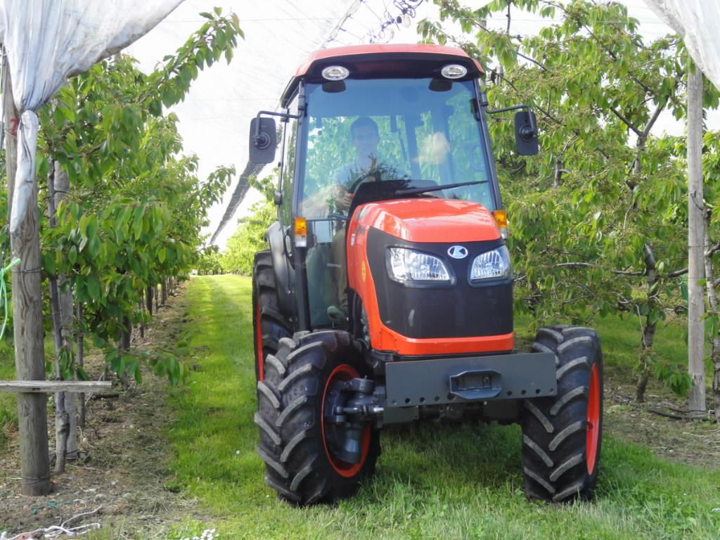Kubota tractor 5640 su 4x4 with attachments, tiller, seeder, fel, planter, deere tractors photo